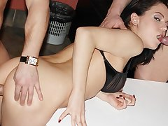 Sweet brunette lassie tackles two steely peckers